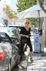 SHARON STONE Picking Up Her Car at Valet Parking