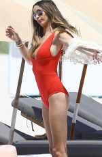 COURTNEY BIGHAM in Red Swimsuit at a Beach in Miami 09/02/2015