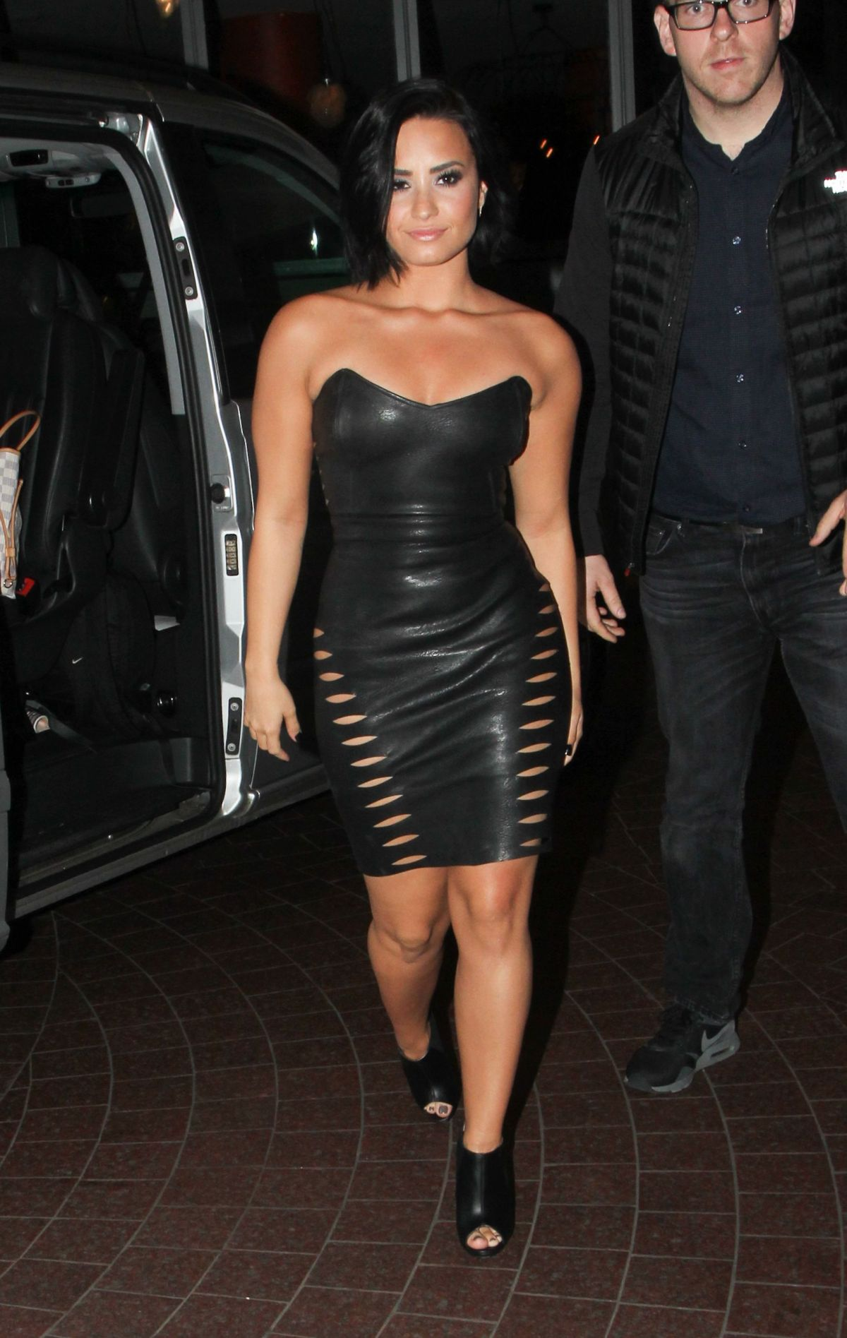 demi lovato in leather skirt arrives at in