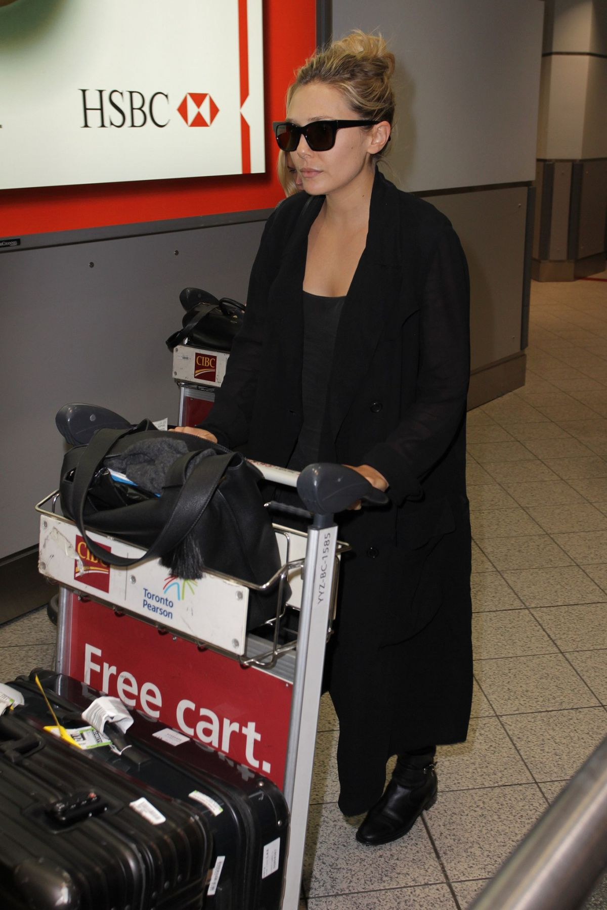 ELIZABETH OLSEN Arrives at Toronto Pearson International Airport 09/11/2015