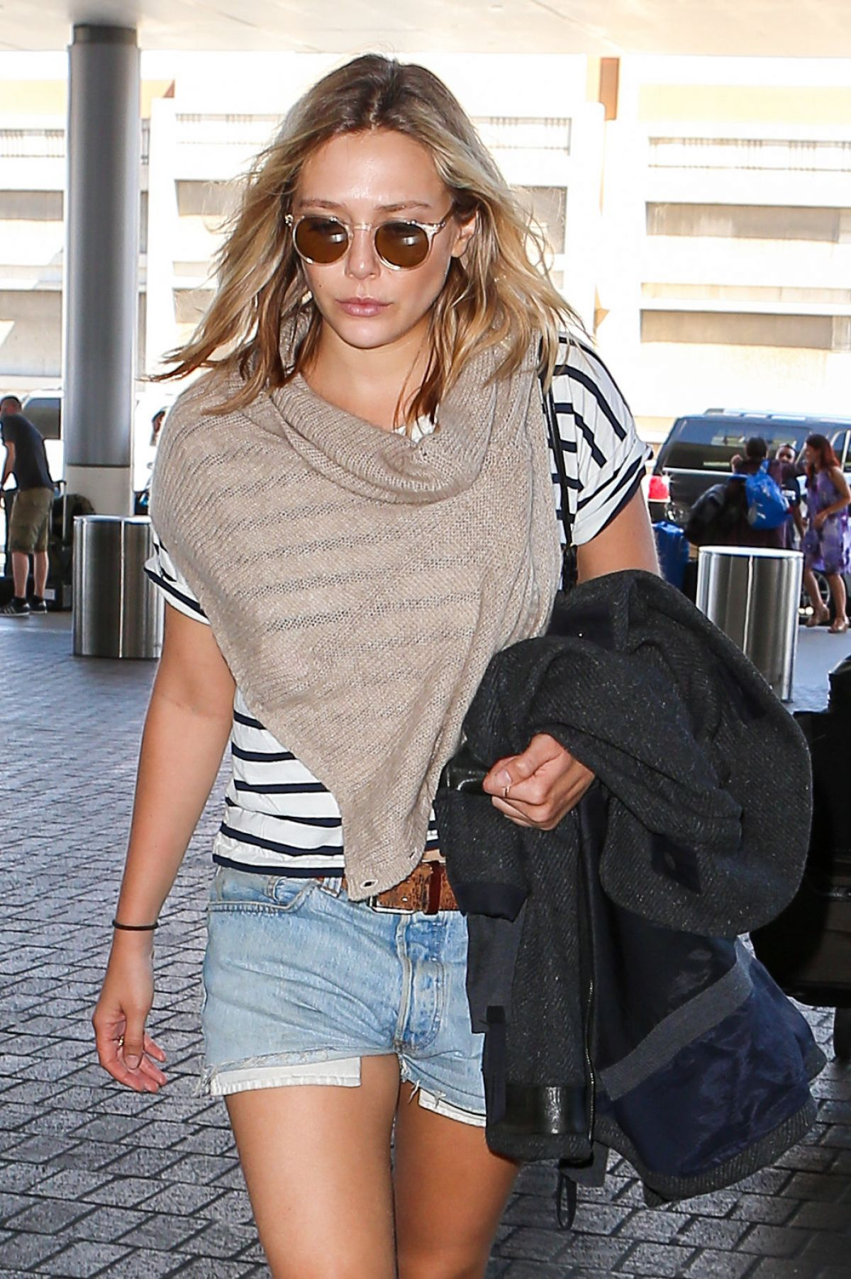 ELIZABETH OLSEN at LAX Airport in Los Angeles 09/28/2015