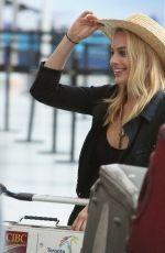MARGOT ROBBIE Arrives at Toronto International Airport 08/28/2015