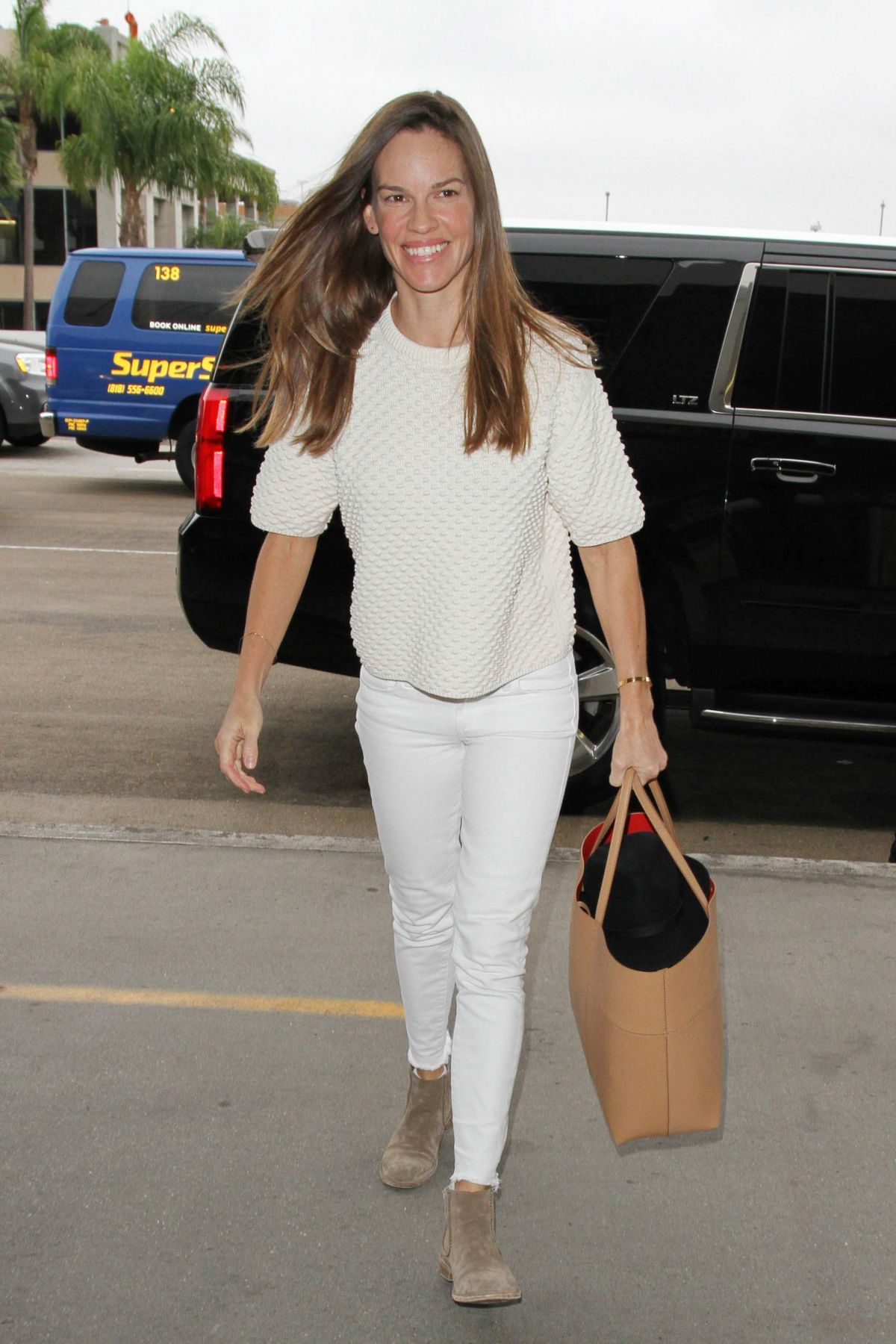 HILARY SWANK Arrives at LAX Airport in Los Angeles 10/16/2015
