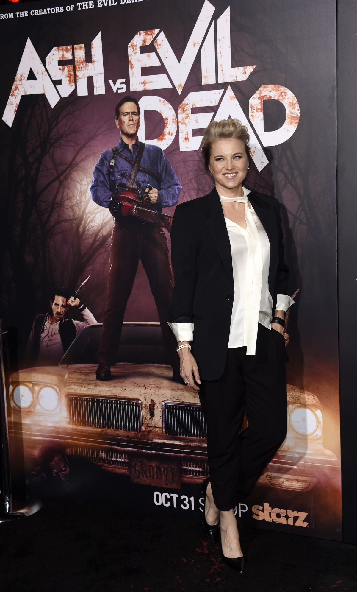 LUCY LAWLESS at Ash vs Evil Dead Premiere in Hollywood 10/29/2015