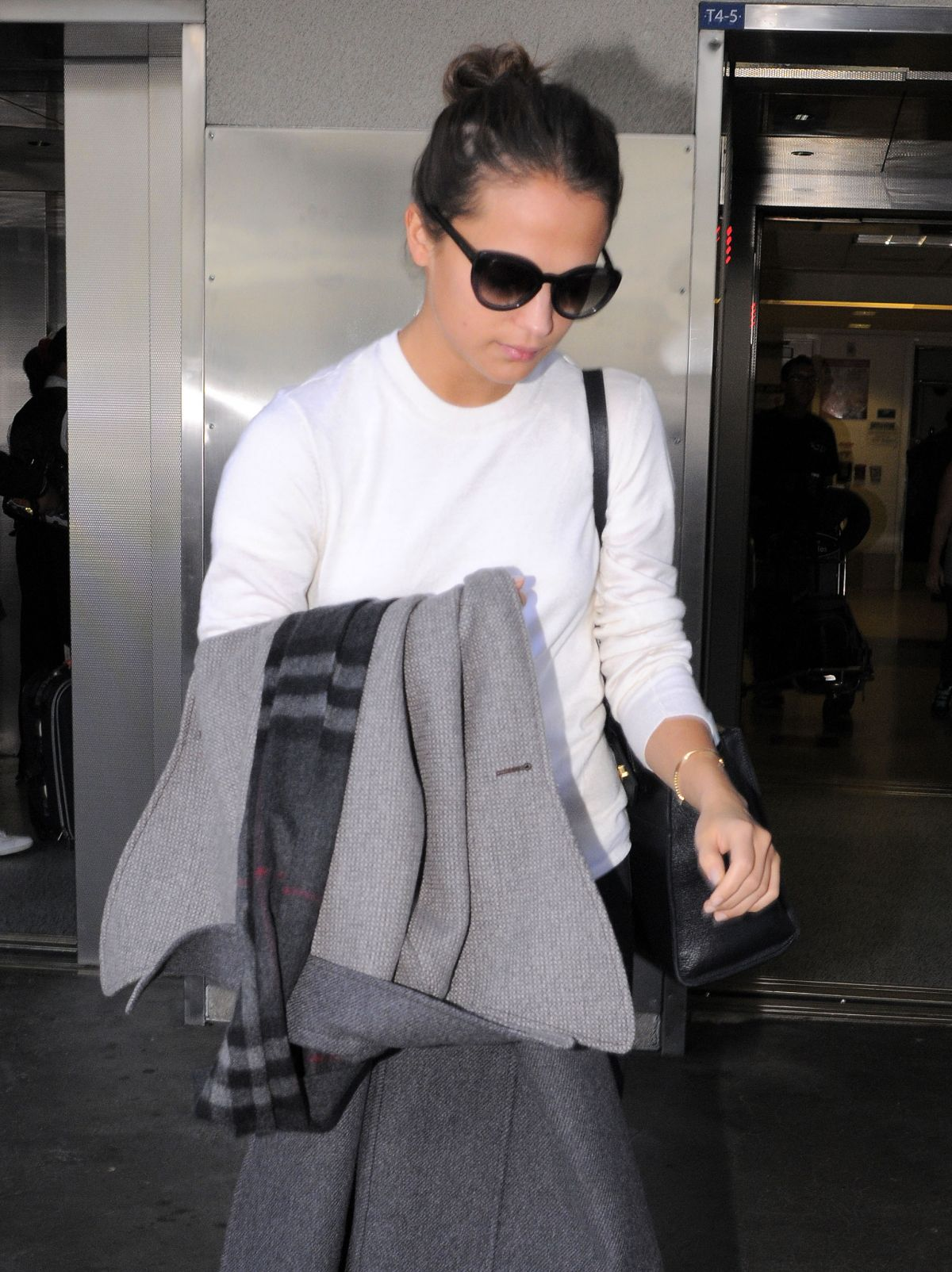 ALICIA VIKANDER at Los Angeles International Airport 11/24/2015