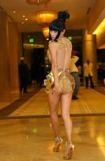BAI LING in a Golden Minidress Night Out in Beverly Hills 11/06/2015
