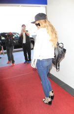 CARMEN ELECTRA Arrives at Los Angeles International Airport 11/04/2015