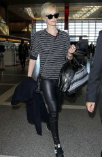 CHARLIZE THERON Arrives at Los Angeles International Airport 11/08/2015