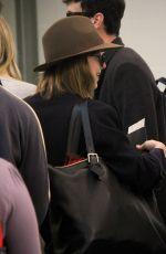 DAKOTA JOHNSON Arrives at LAX Airport in Los Angeles 11/19/2015