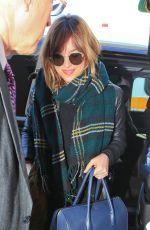 DAKOTA JOHNSON Arrives at Los Angeles International Airport 11/02/2015