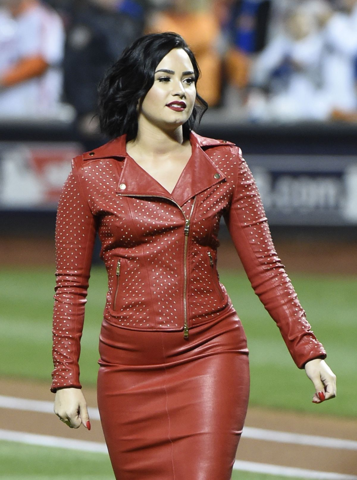 DEMI LOVATO Sings National Anthem at MLB World Series Game Four at The Citi Field in New York 10/31/2015