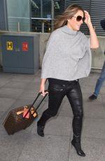 ELIZABETH HURLEY Arrives Back at Heathrow Airport 11/18/2015