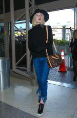 ELLE FANNING Arrives at Los Angeles International Airport 11/04/2015