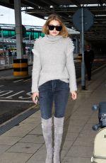 GIGI HADID at Heathrow Airport in London 11/30/2015