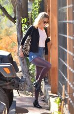 JANUARY JONES in Jeans Shorts Shopping in Los Angeles 11/21/2015