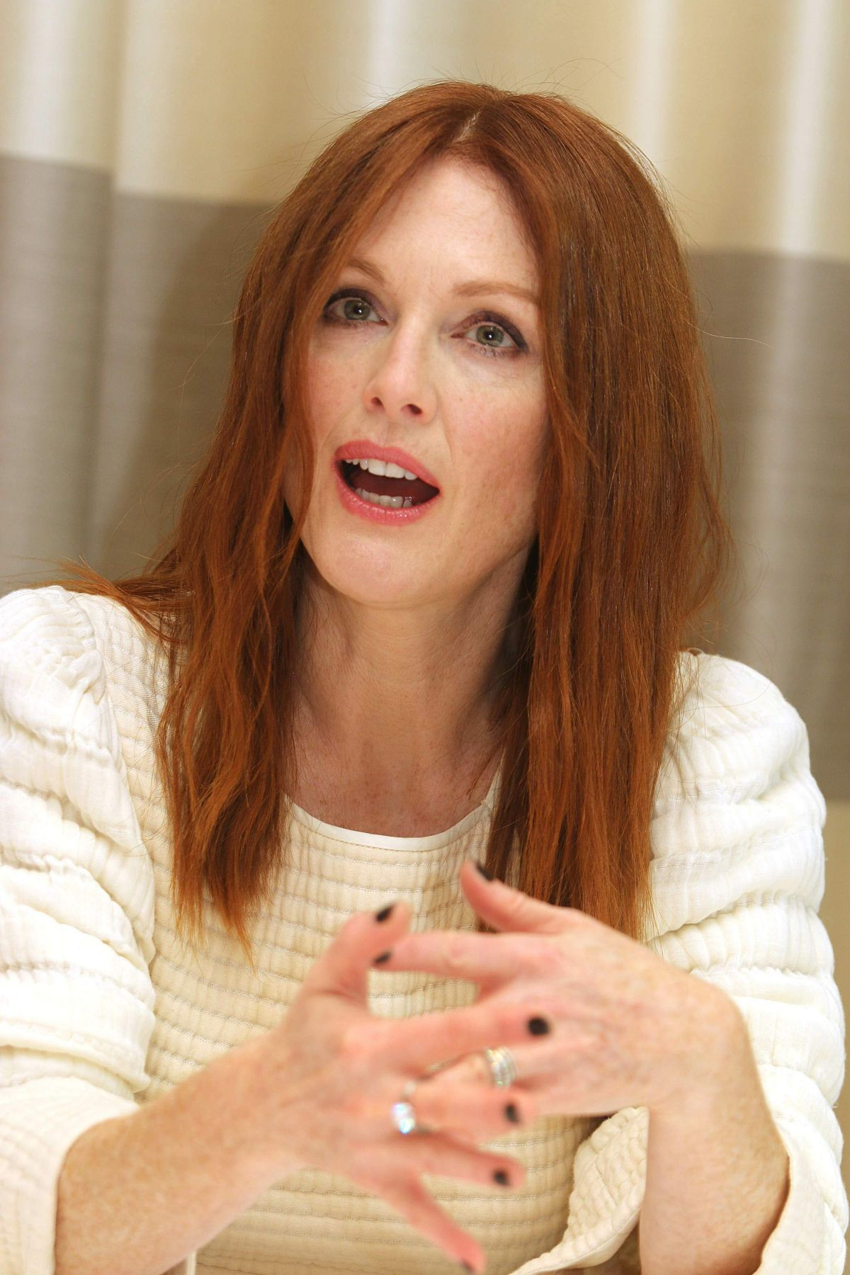 JULIANNE MOORE at The Hunger Games: Mockingjay, Part 2 Press Conference in Berlin 11/03/2015