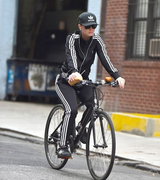 KATY PERRY Riding Her Bike Out in New York 11/06/2015
