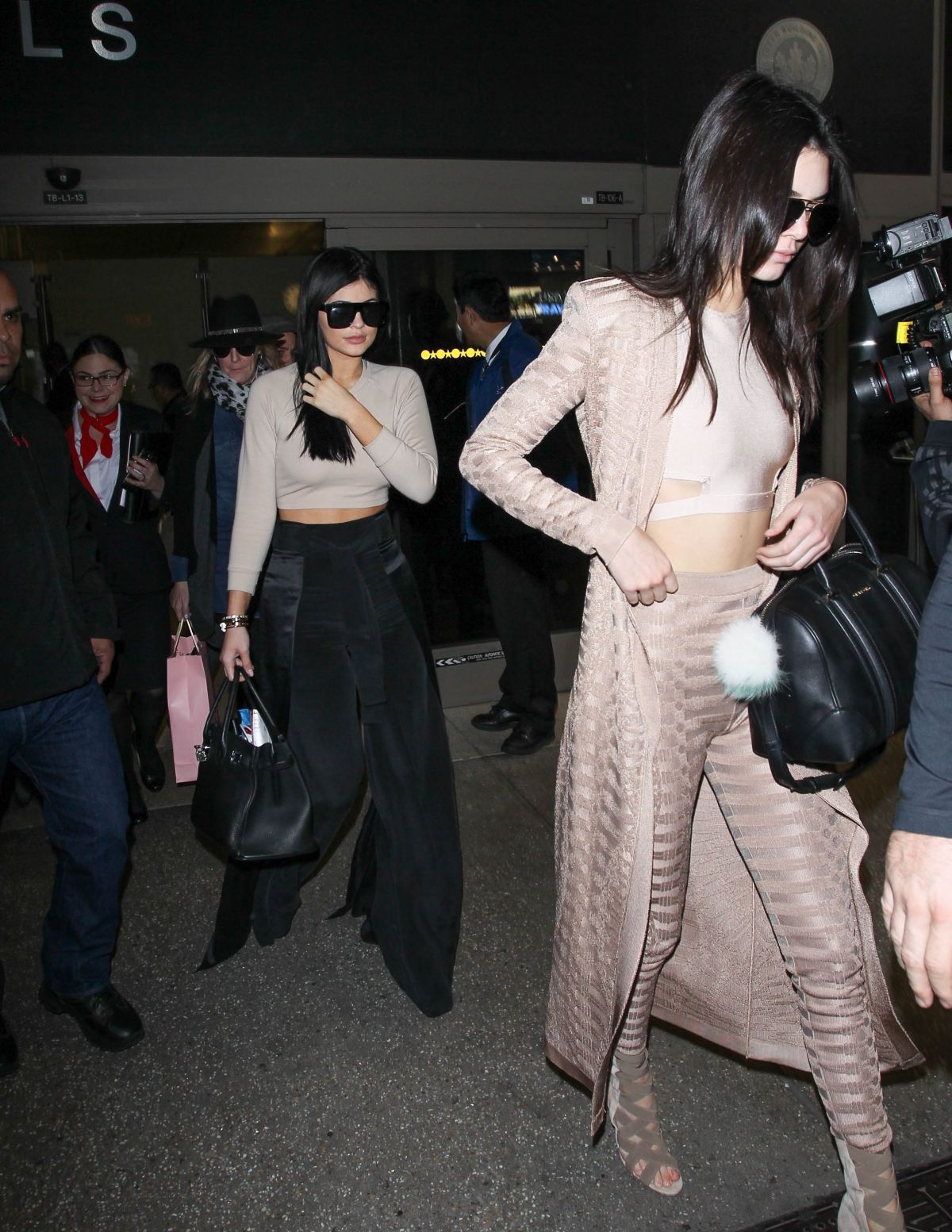 KENDALL and KYLIE JEENER Arrives at LAX AIrport in Los Angeles 11/19/2015