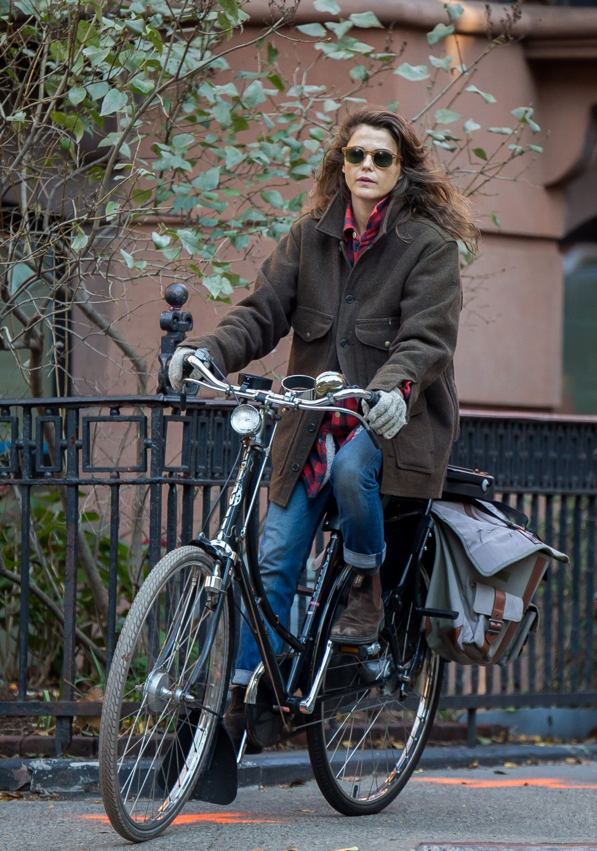 KERI RUSSELL Riding a Bike Out in New York 11/25/2015