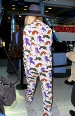 KESHA Arrives at LAX Airport in Los Angeles 11/25/2015