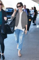 LILY COLLINS Arrives at LAX Airport in Los Angeles 11/08/2015