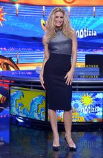 MICHELLE HUNZIKER at Strip The News Photocall in Milan 10/26/2015
