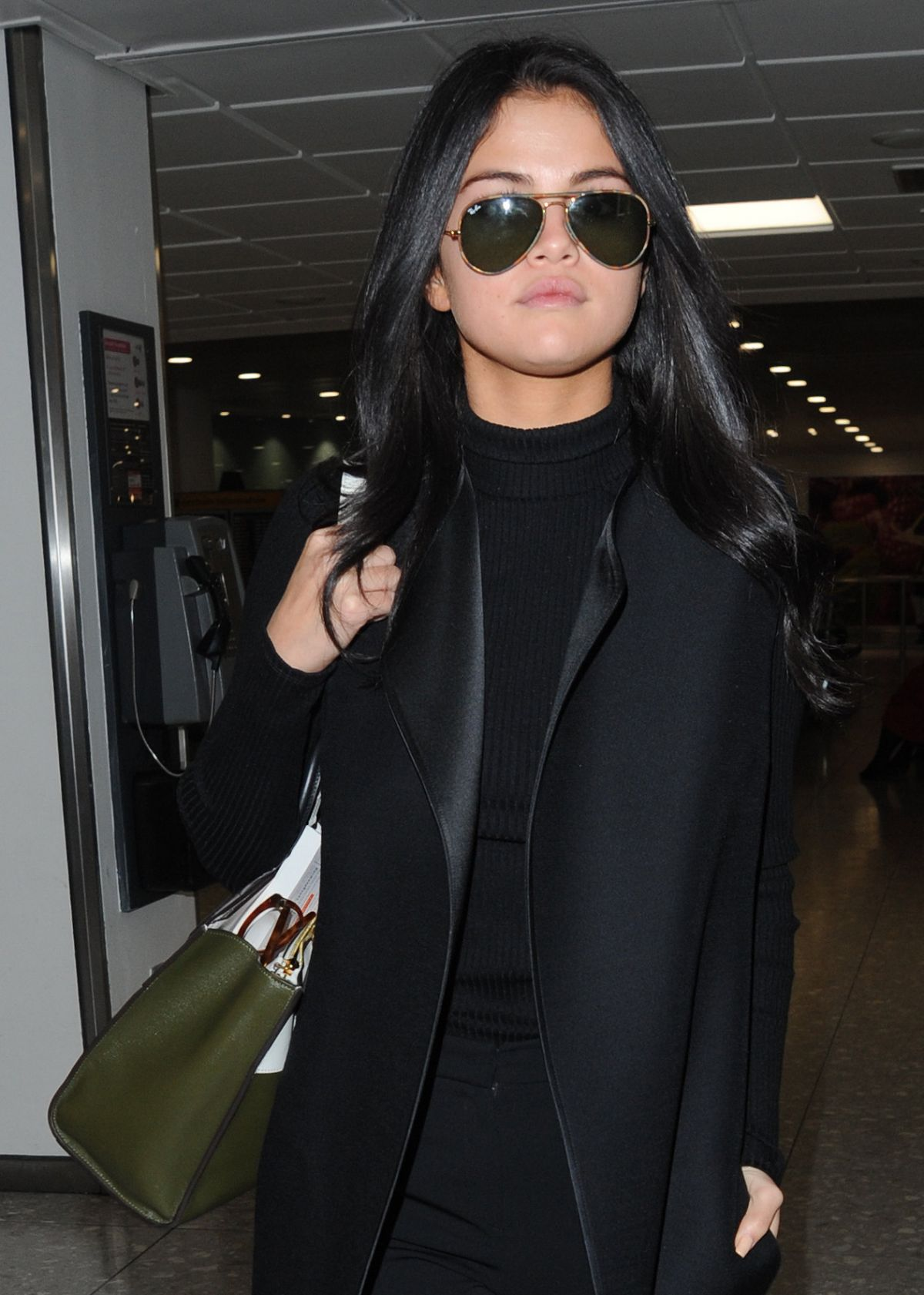 SELENA GOMEZ at Heathrow Airport in London 11/12/2015