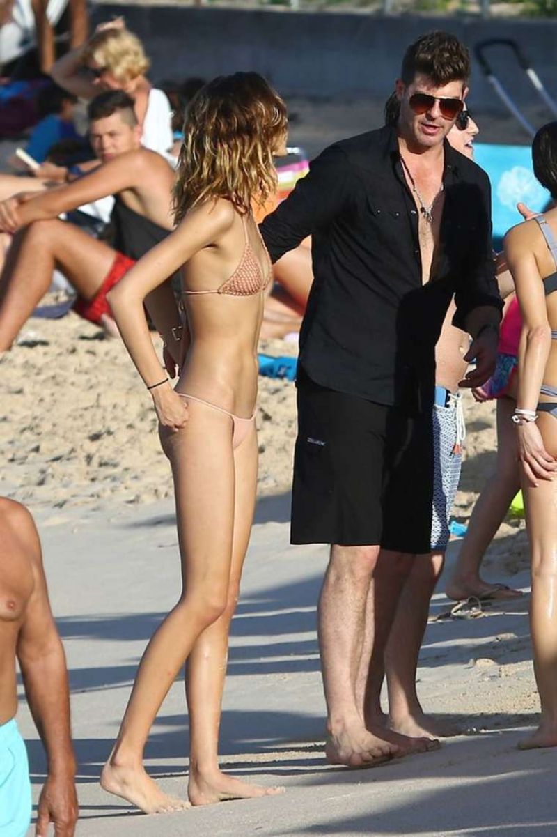 APRIL LOVE GEARY in Bikini on the Beach in St. Barts 12/30/2015