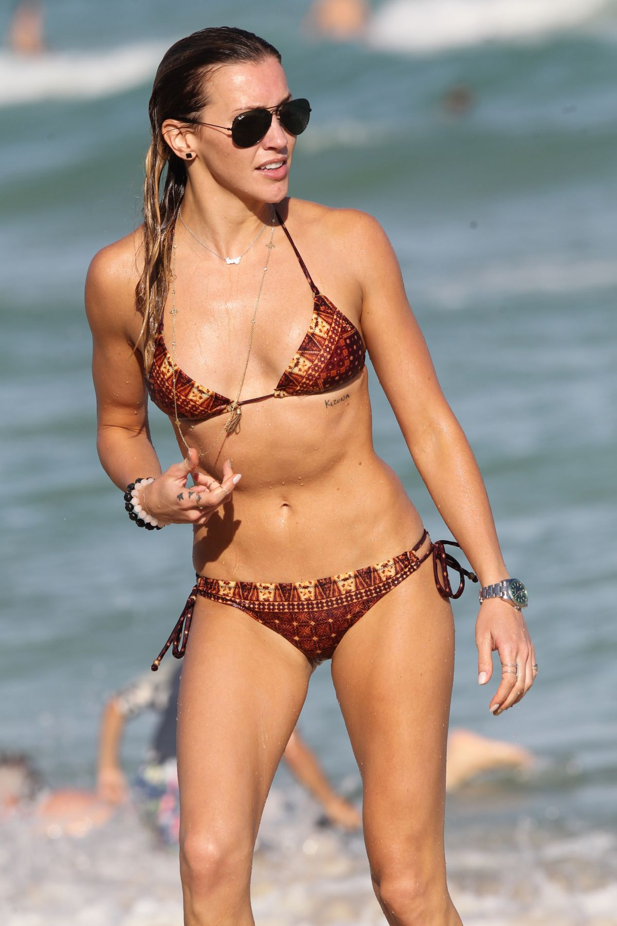 KATIE CASSIDY in Bikini at a Beach in Miami 12/28/2015