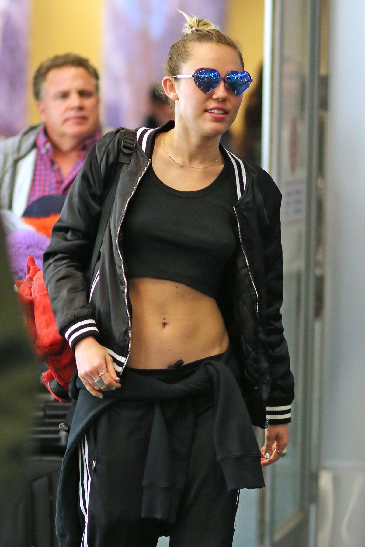 MILEY CYRUS at Vancouver International Airport 12/14/2015