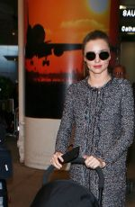 MIRANDA KERR at Los Angeles International Airport 12/27/2015