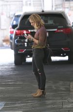 BRITTANY SNOW Waits for Her Car in Beverly Hills 01/28/2016