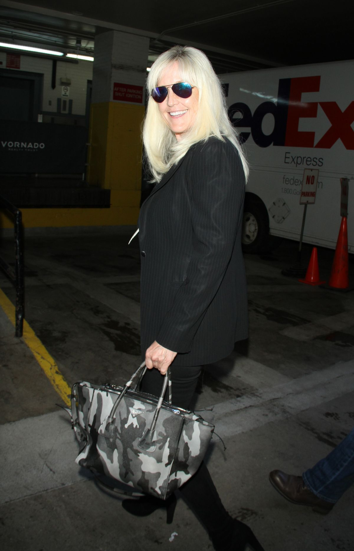 ERIN BROCKOVICH Arrives at Huffpost Live in New York 01/28/2016