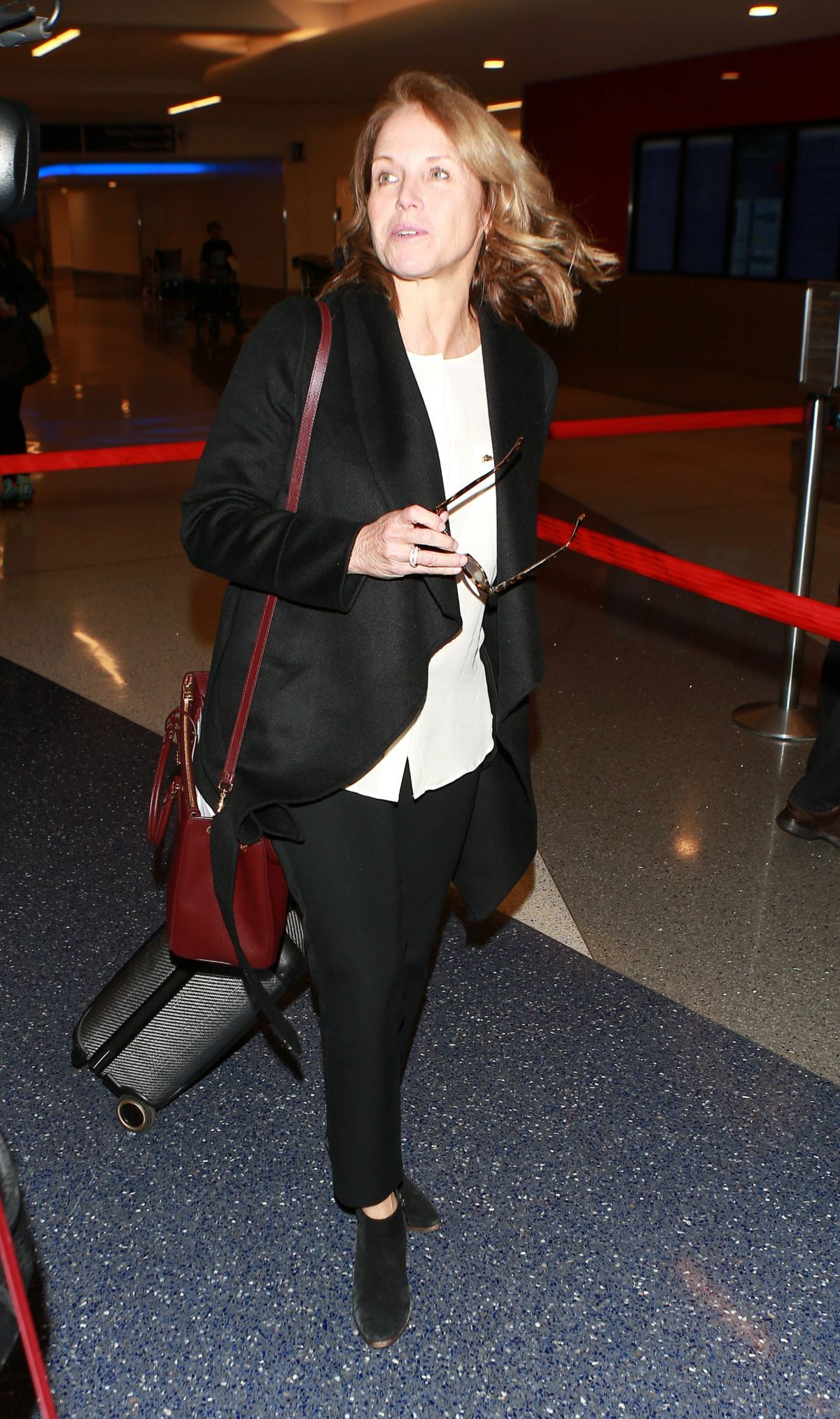 KATIE COURIC at LAX Airport in Los Angeles 01/19/2016