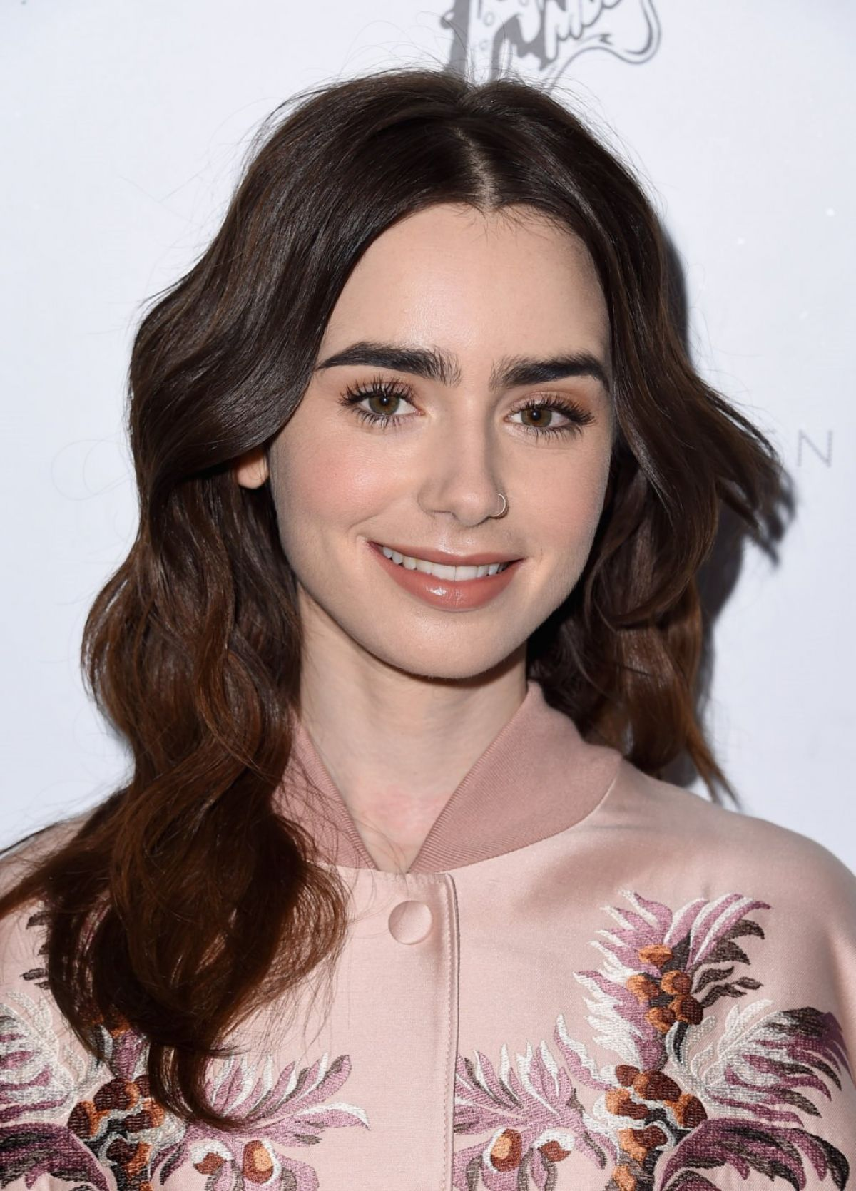 LILY COLLINS at Stella...