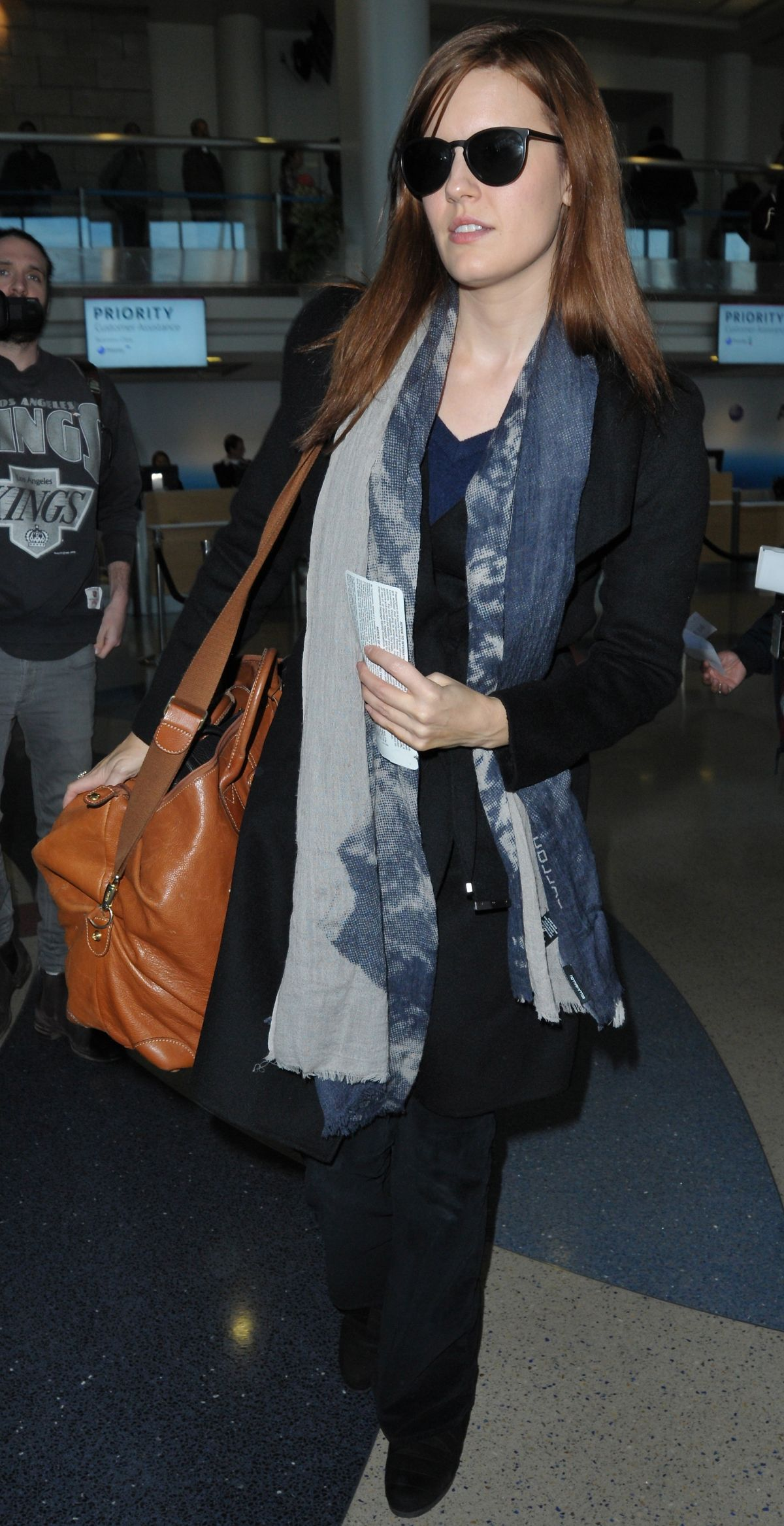 MAGGIE GRACE Arrives at Los Angeles International Airport 01/12/2016