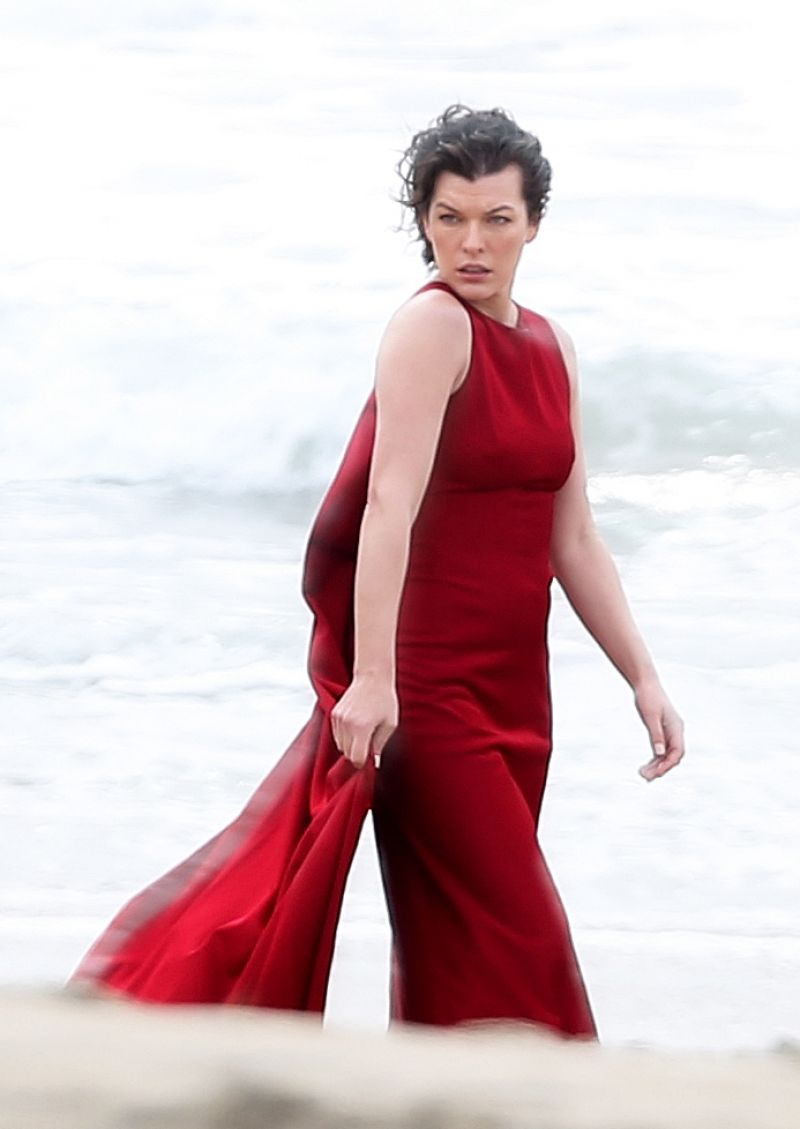 MILLA JOVOVICH on the Set of a Photoshoot in Malibu 01/19/2016 ...