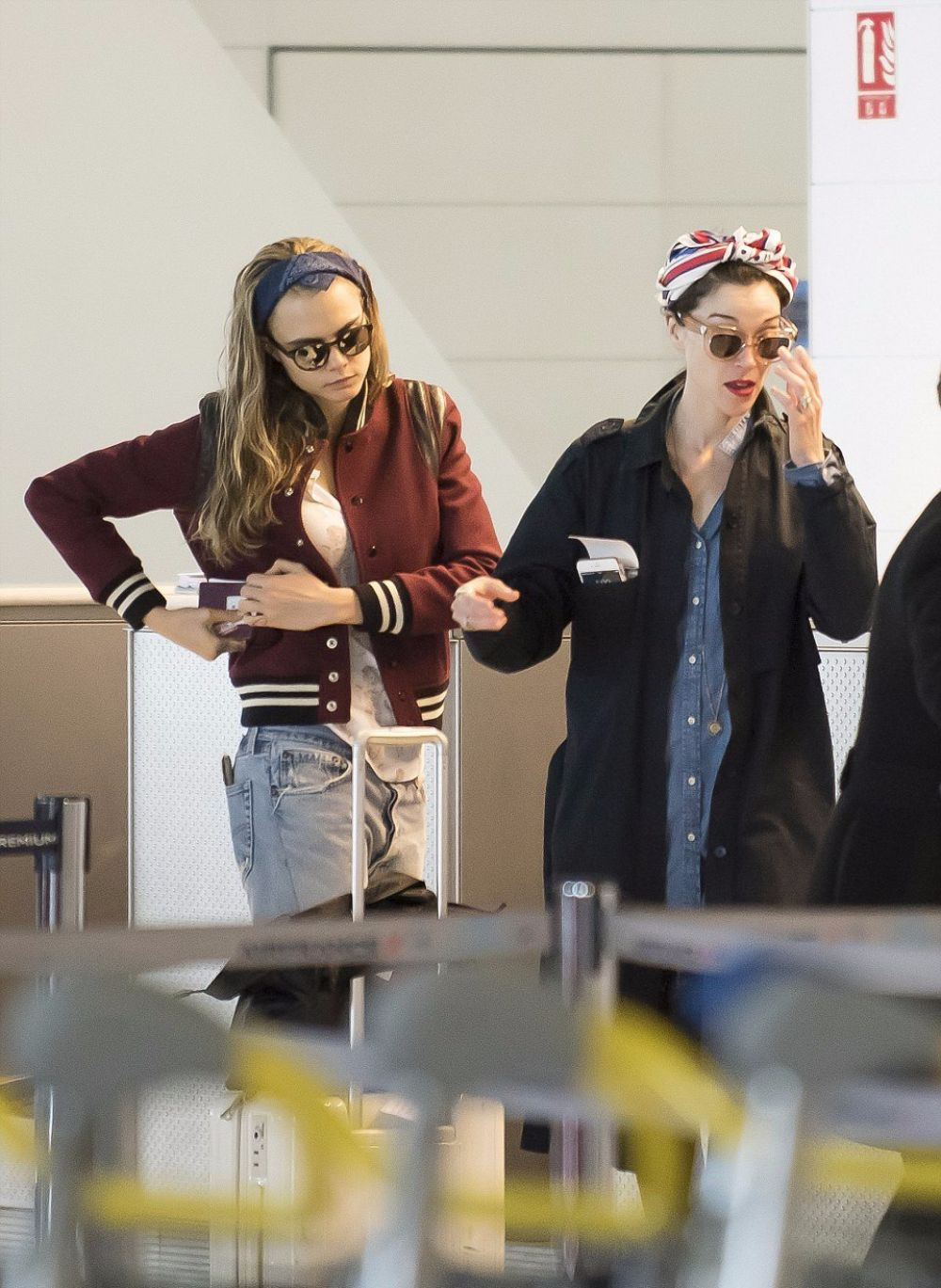 CARA DELEVINGNE and ANNIE CLARK at Charles De Gaulle Airport in Paris 02/20/2016