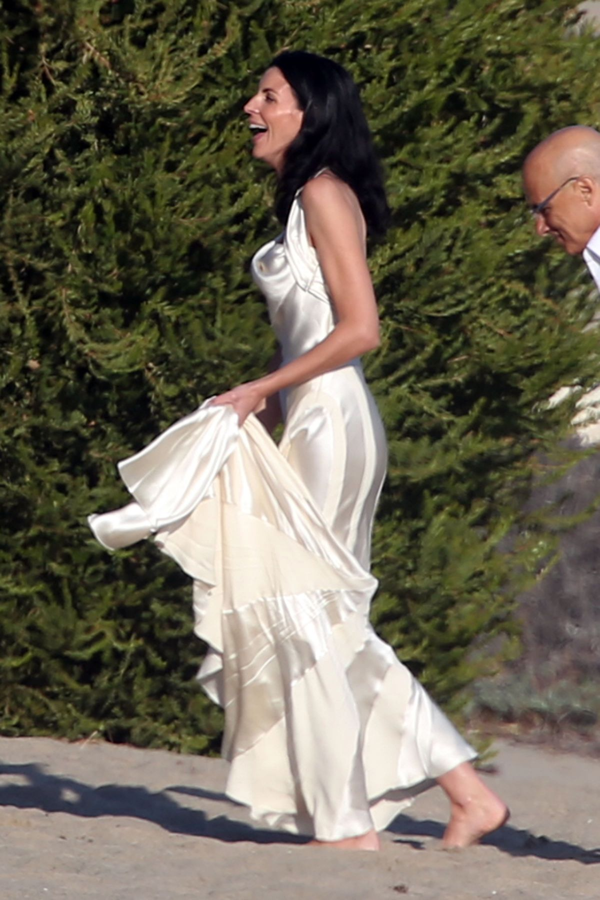 Liberty ross at a wedding ceremony on the beach in malibu for Ross wedding dresses