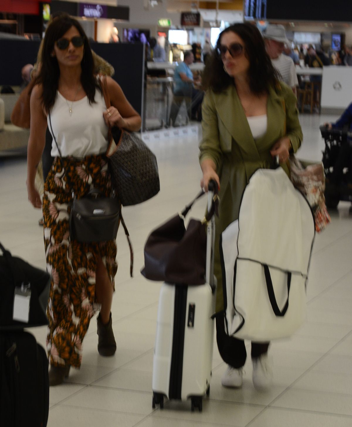 NATALIE IMBRUGLIA and TINA ARENA at Airport in Adelaide 02/13/2016