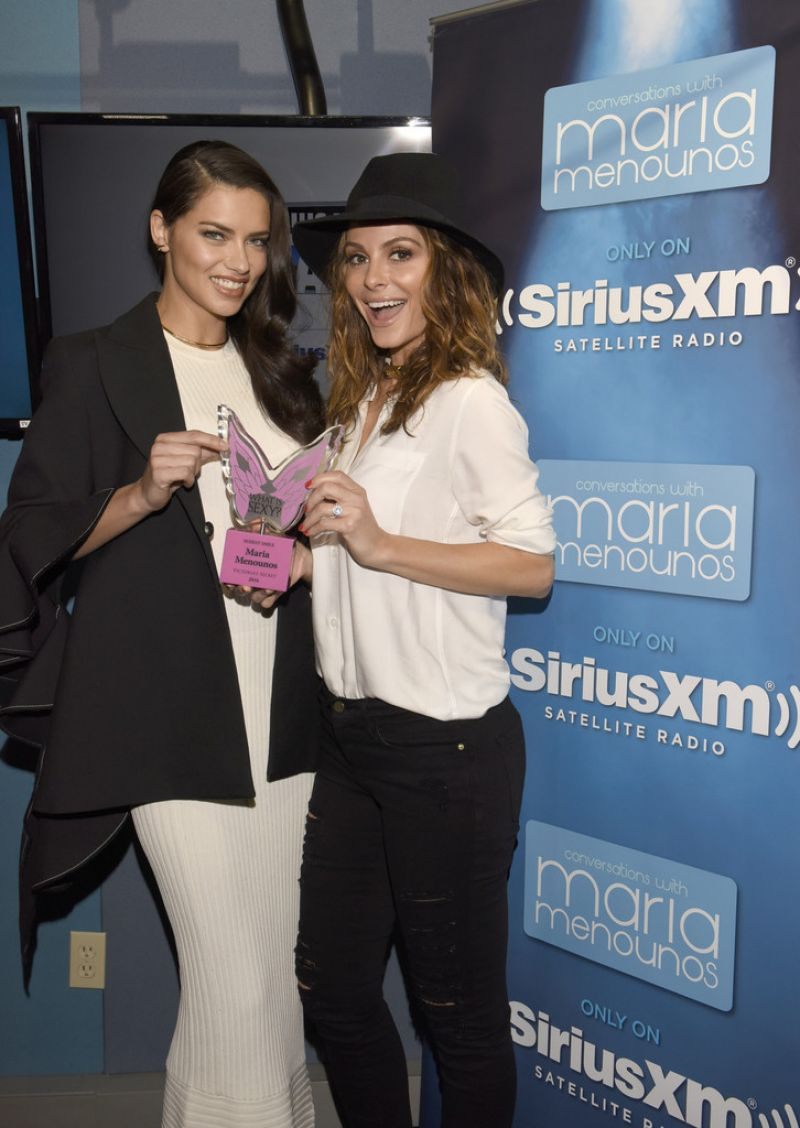 ADRIANA LIMA Giving MARIA MENOUNOS an Award at SiriusXM Studios in Los Angeles 03/24/2016