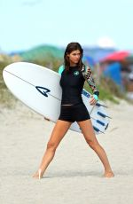 ALEXANDRA DADDARIO in Wetsuit on the Set of