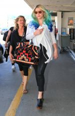 KESHA SEBERT at Los Angeles International Airport 03/19/2016