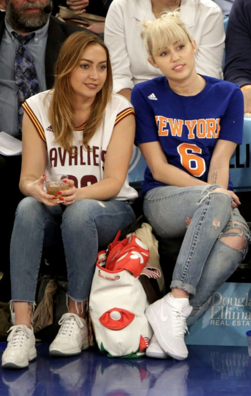 MILEY and BRANDI CYRUS at Madison Square Garden in New York 03/27/2016