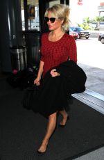 PAMELA ANDERSON Arrives at Los Angeles International Airport 03/24/2016