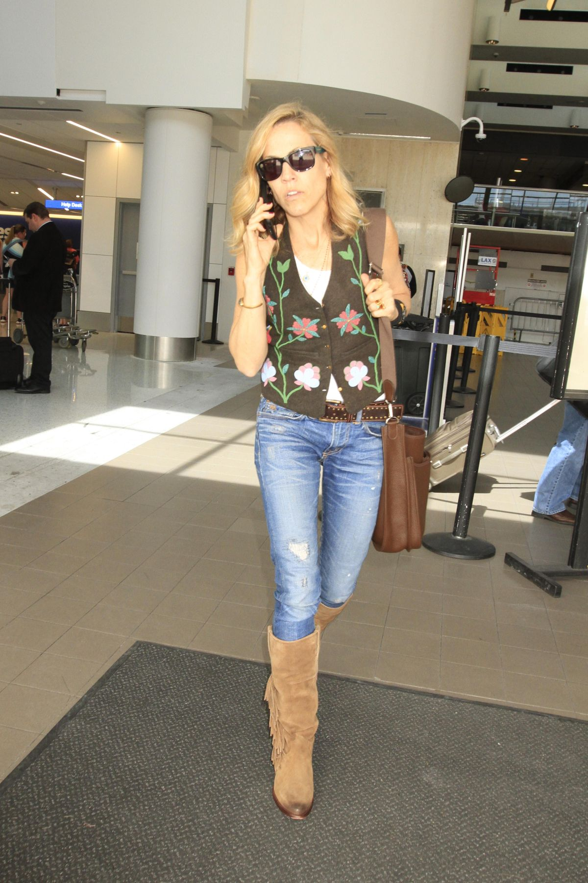 SHERYL CROW at LAX Airport in Los Angeles 03/10/2016