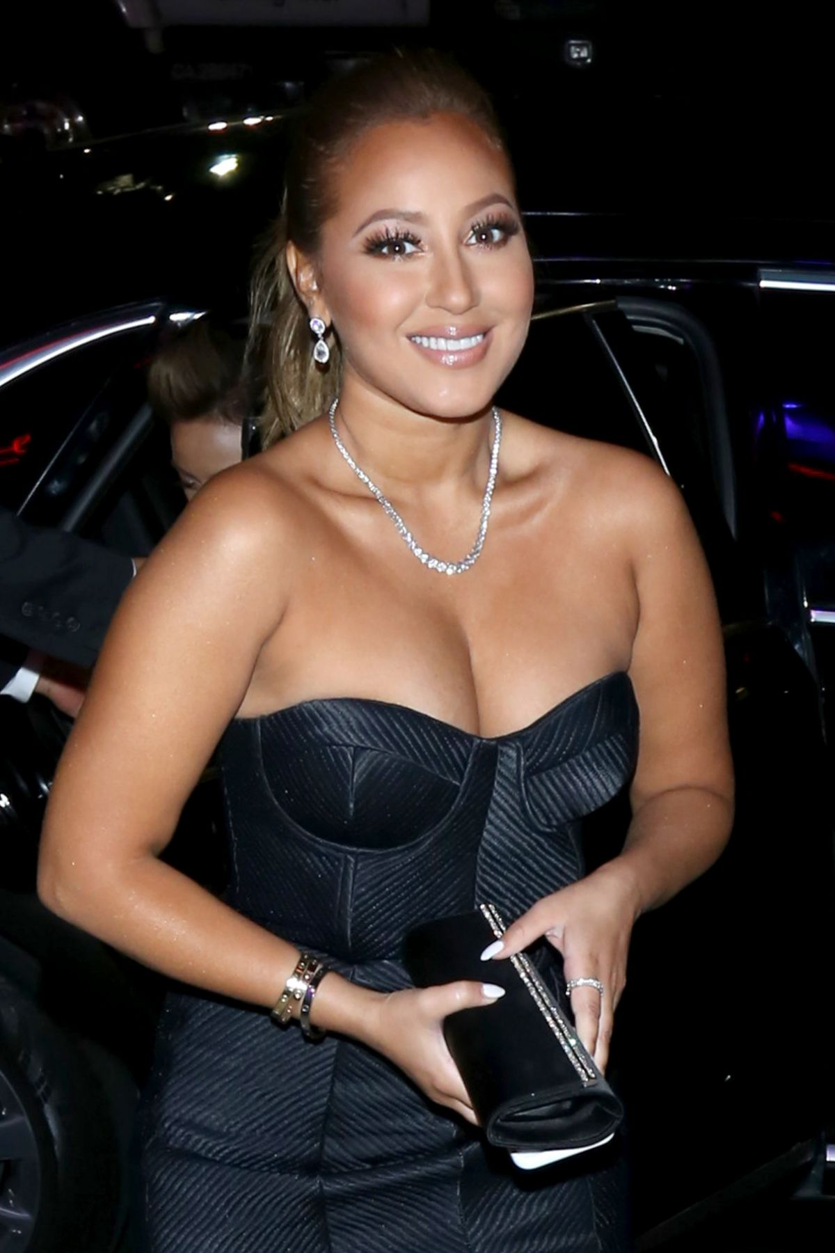 ADRIENNE BAILON Arrives at Mel