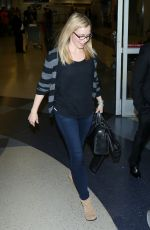 AMANDA SCHULL at LAX Airport in Los Angeles 04/24/2016