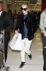 ASHLEY BENSON at LAX Airport in Los Angeles 04/08/2016