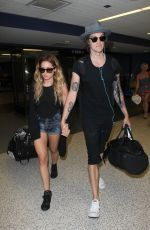ASHLEY TISDALE at Los Angeles International Airport 04/25/2016